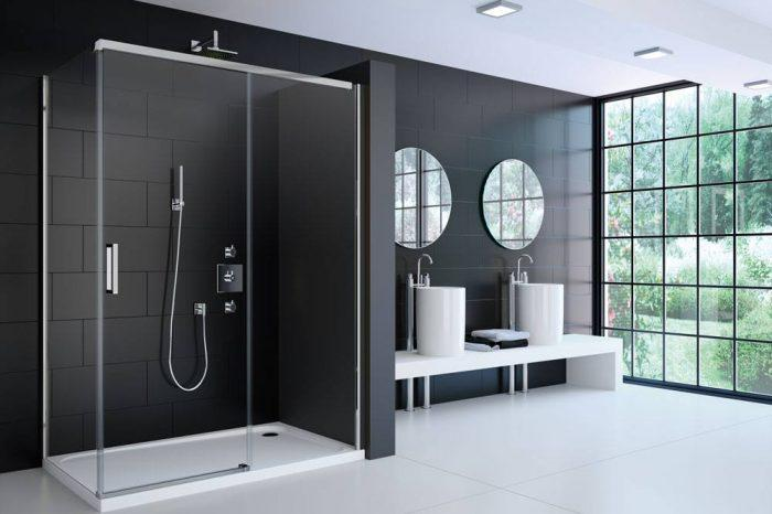 Merlyn large glass shower enclosure for black and white tiled bathroom design